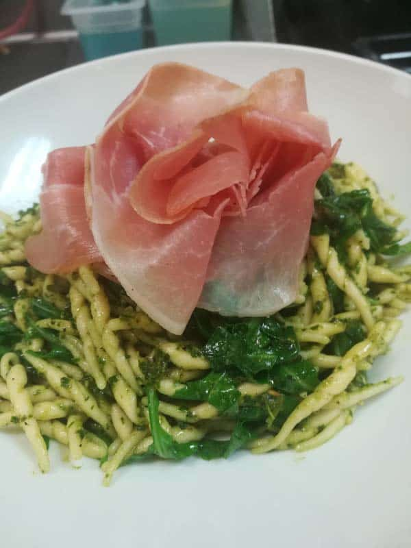 Trofie pasta with pesto Genovese and Prosciutto rose